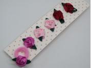 Colita con aplique rosa de raso x tira